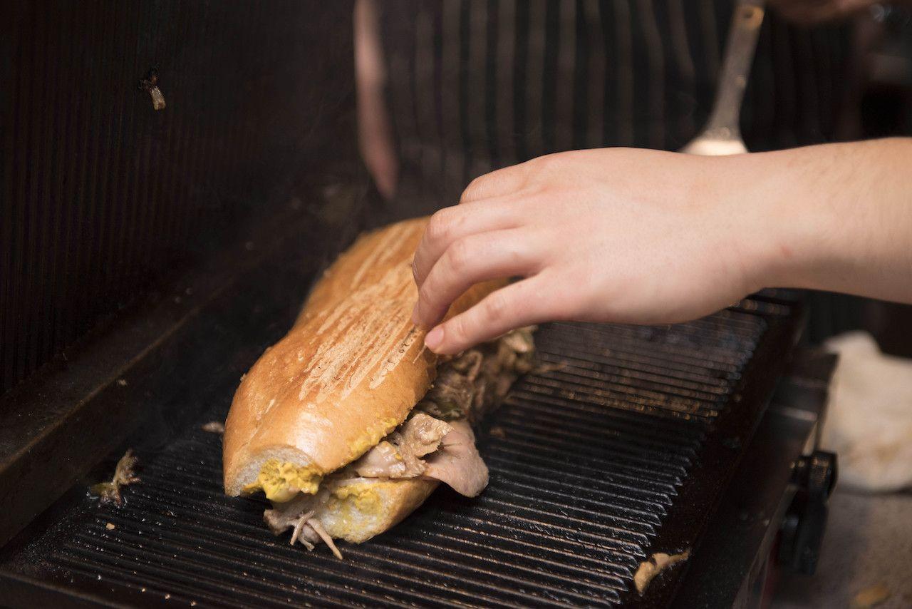 Cuban sandwich being grilled