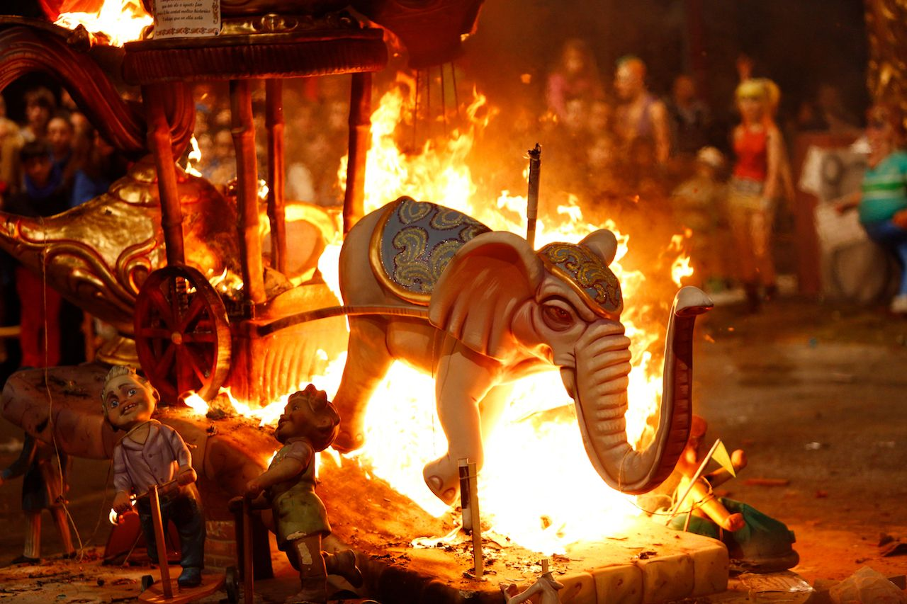 Figure of Fallas burning the day of the Crema in the traditional burning of stone dollspaper