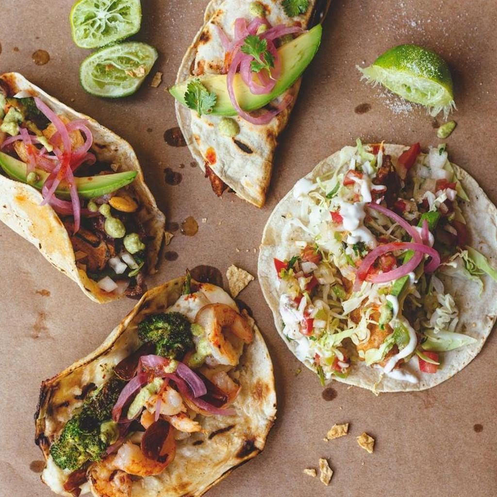 Fish tacos with avocado and lime