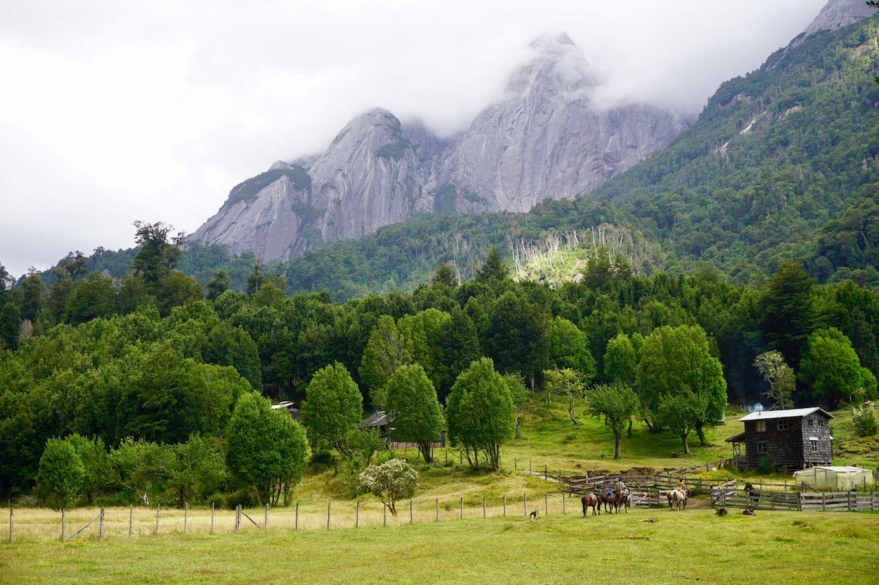 Gauchos riding into Camp Aventura, Cochamo, Chile