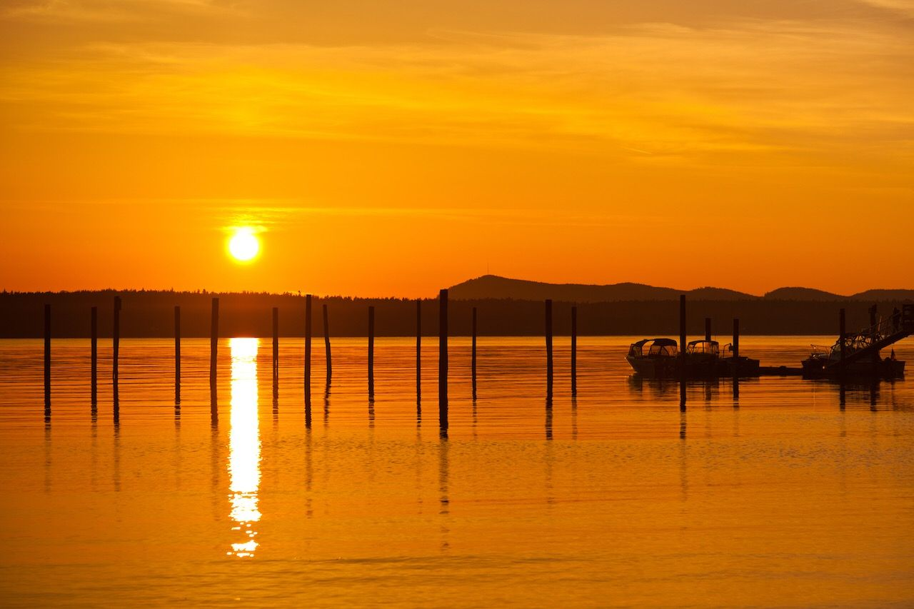 Golden orange sunset in Anacortes, WA Ship Harbor on Fidalgo Island