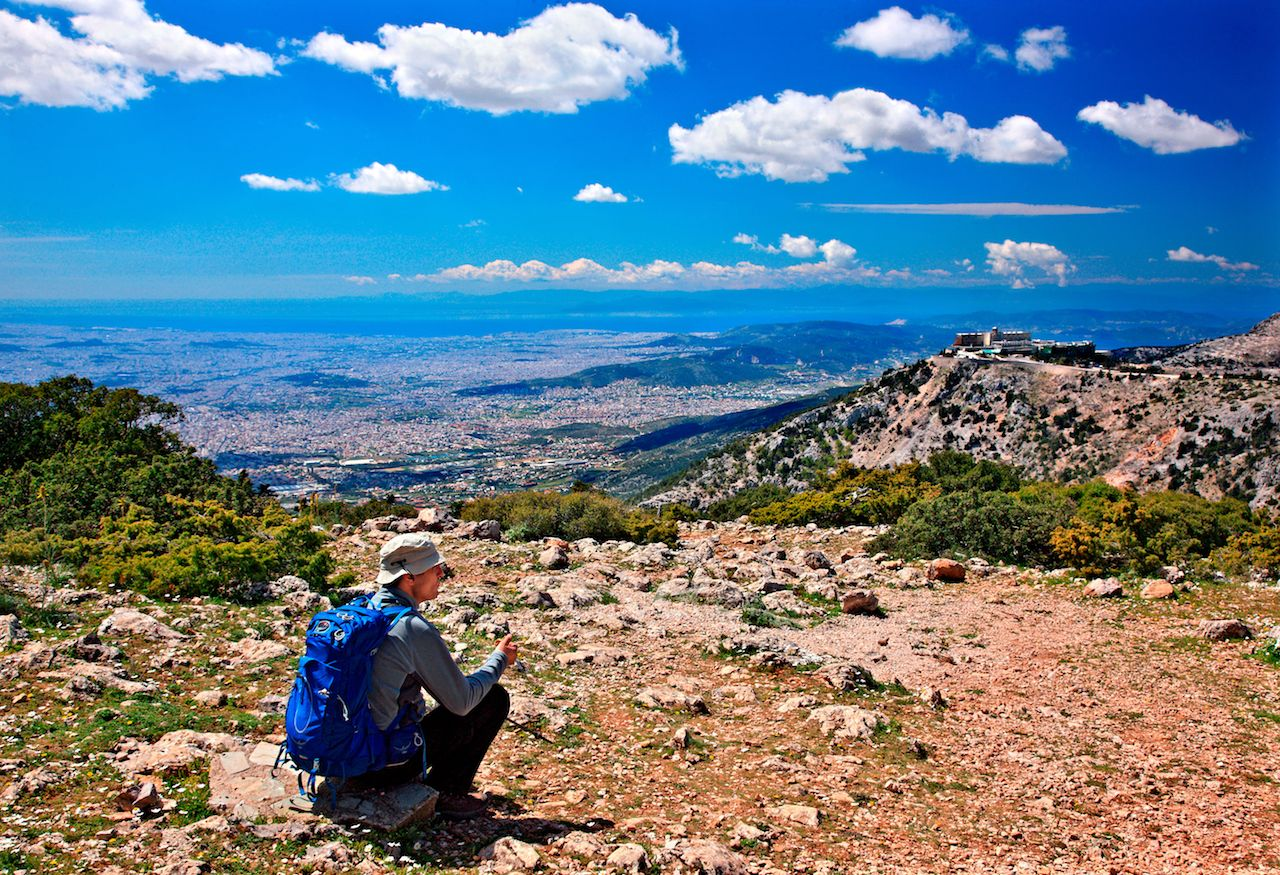 Hiker enjoying the view of Athens from Parnitha mountain
