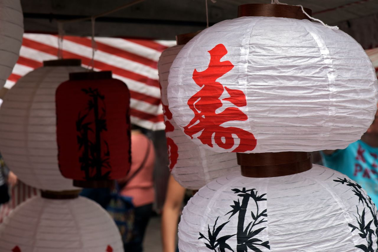 Japanese paper lanterns on the open-air market stall.