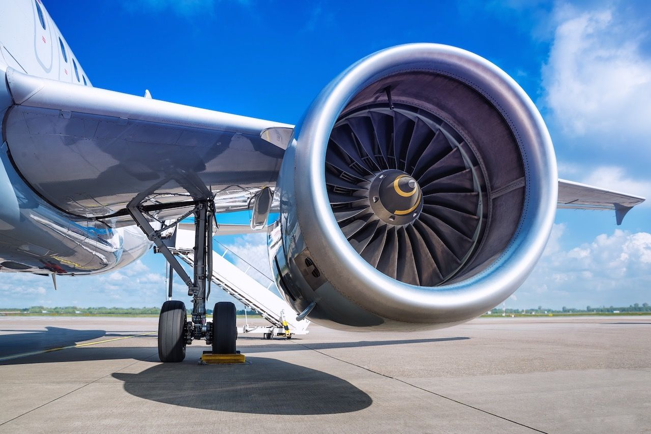 Passenger tossed coins in jet
