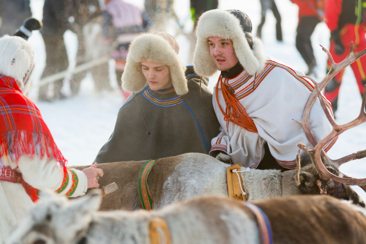 Jokkmokk Winter Market in Lapland with reindeer and indigenous dress
