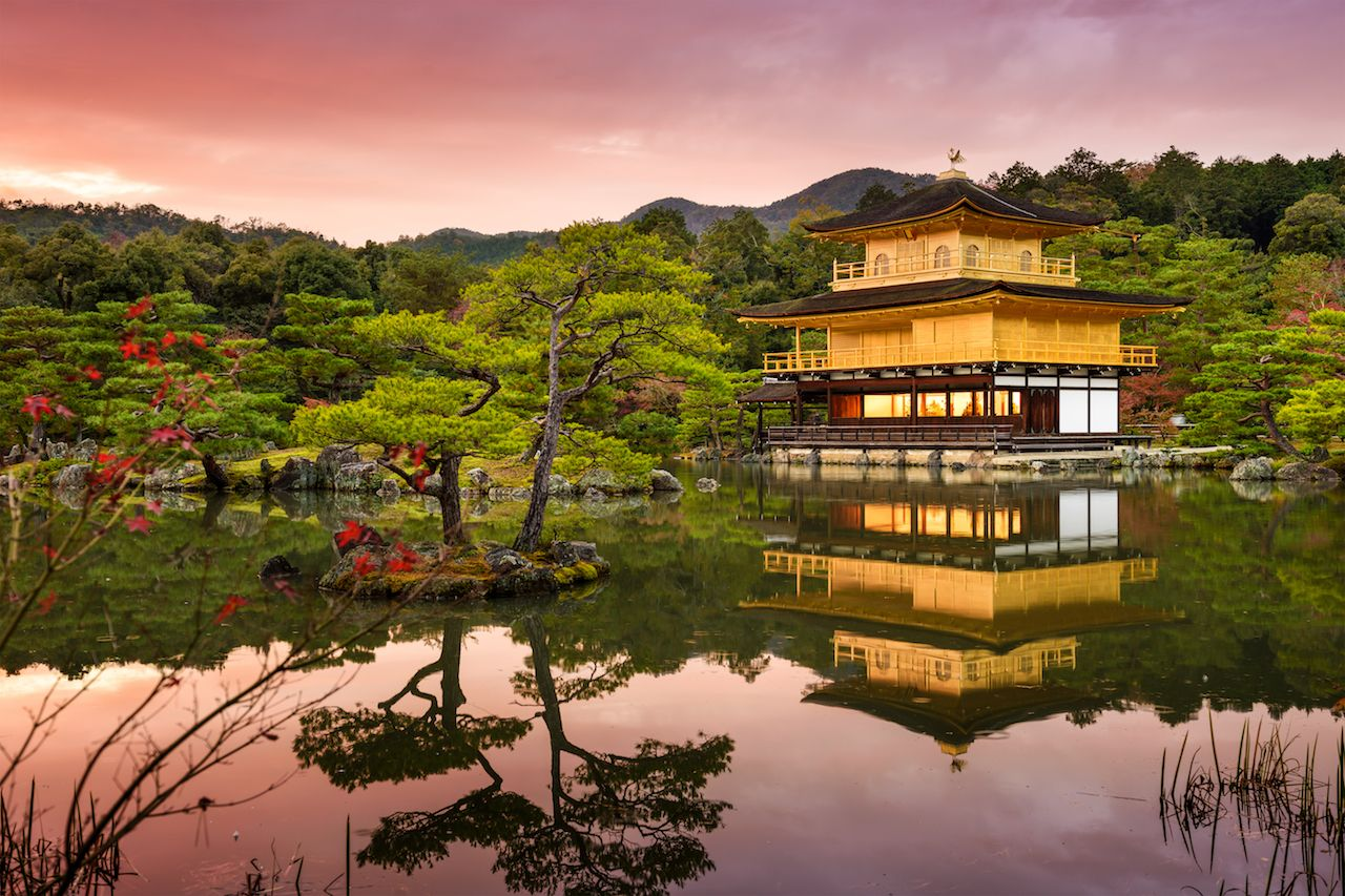 Kyoto, Japan at the Golden Pavilion at dusk