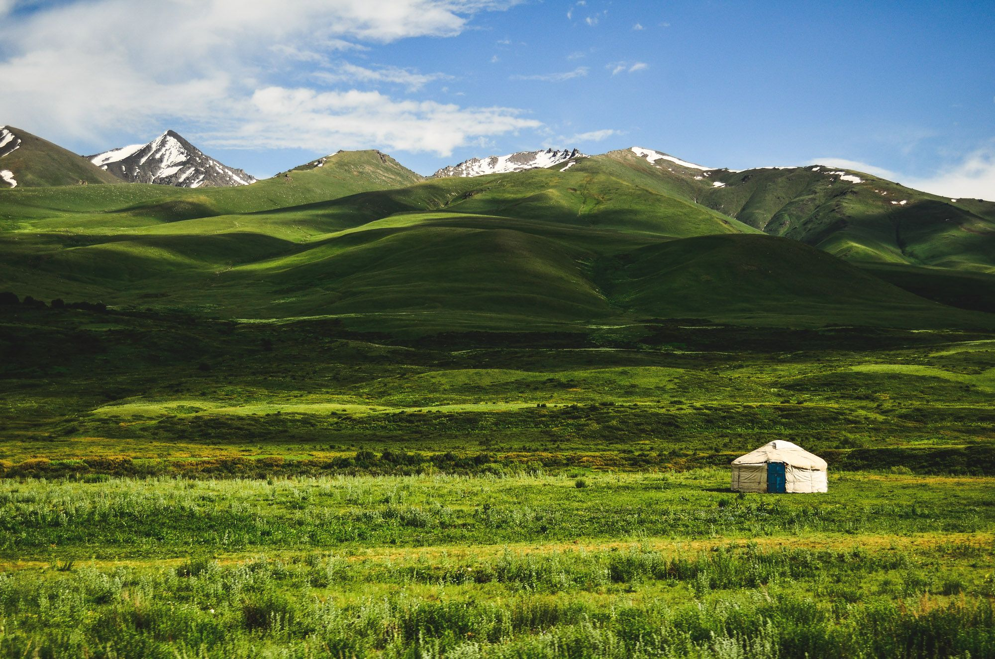 Kyrgyzstan yurt and green landscape