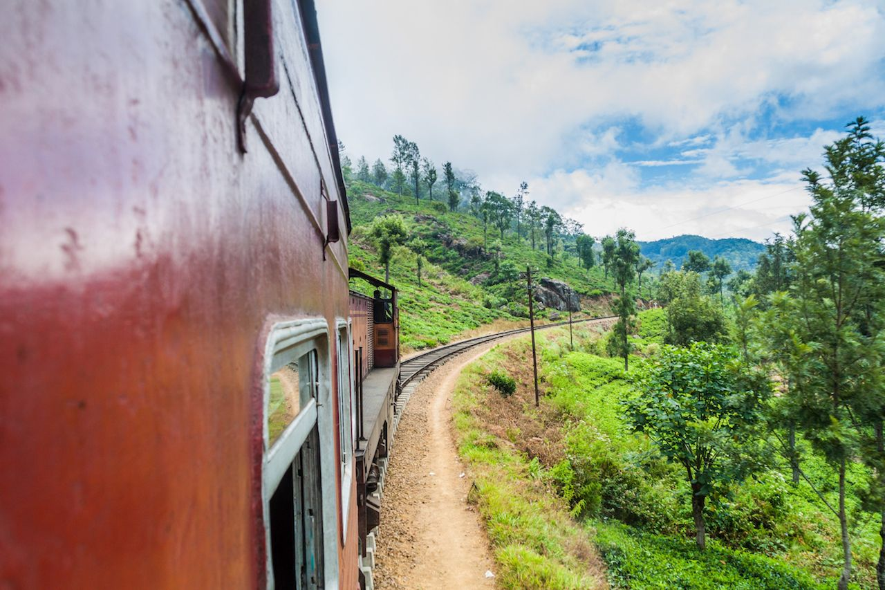 Local train rides in hills near Idalgashinna village, Sri Lanka