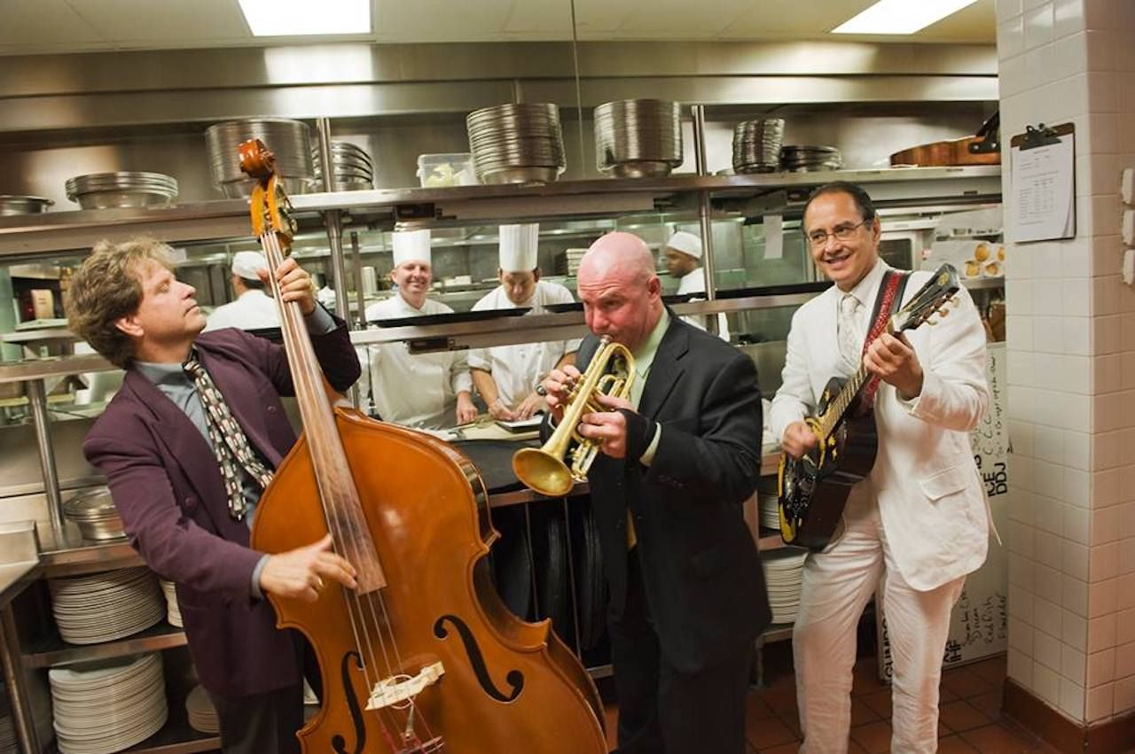 Musicians playing in a restaurant kitchen
