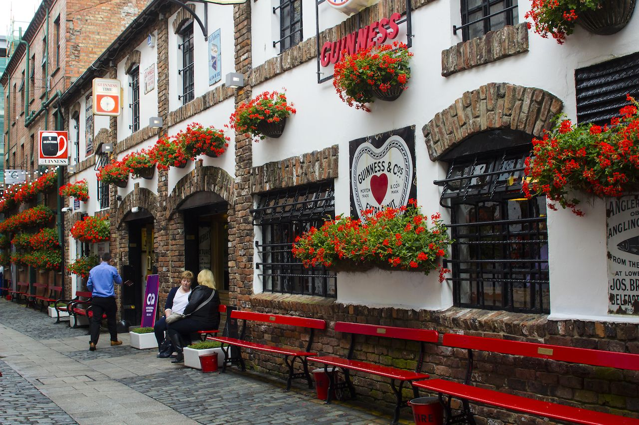 Patrons outside the historic Duke of York pub in Commercial Lane in Belfast, Northern Ireland