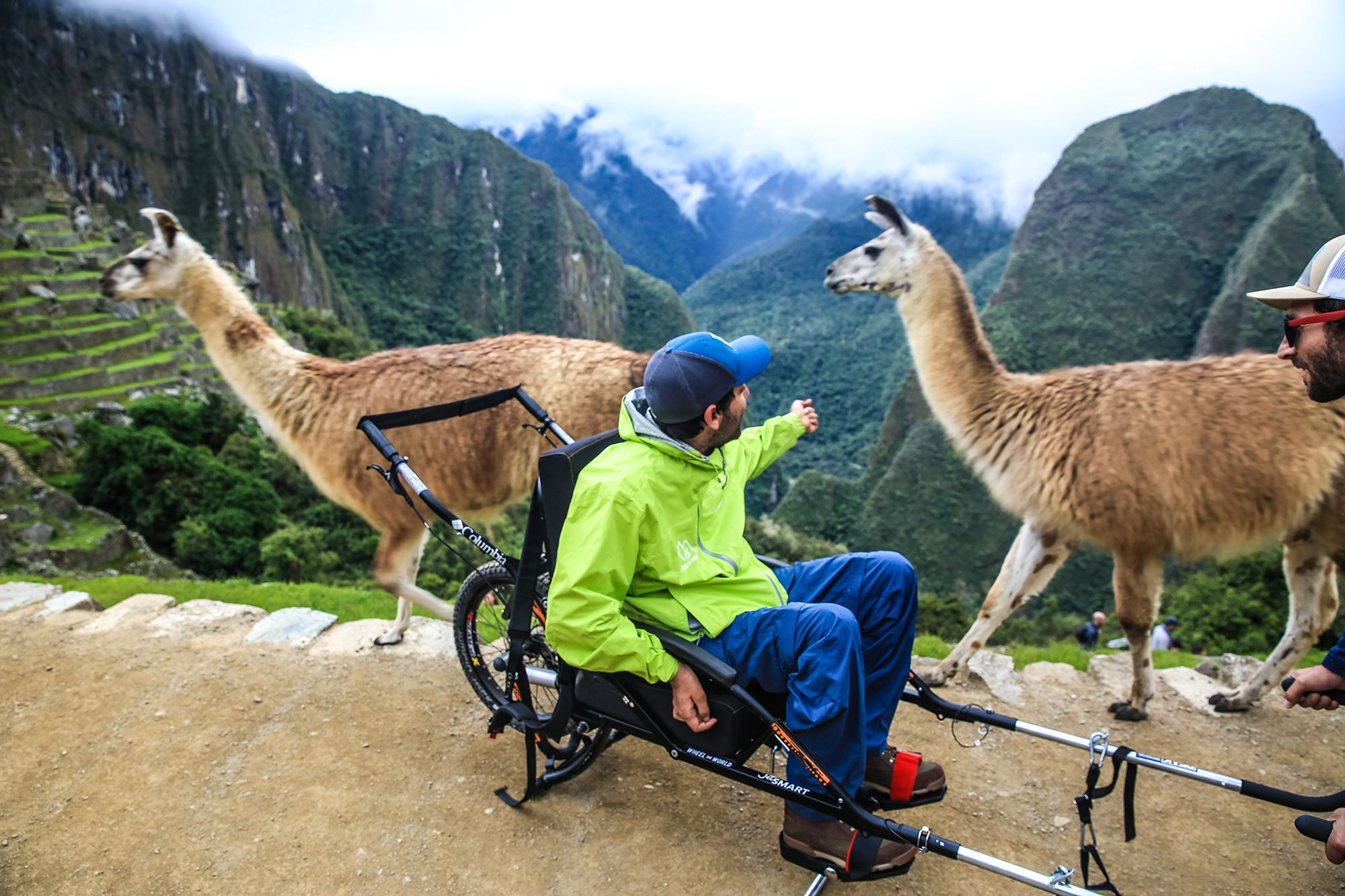 Person in special wheelchair designed for Machu Picchu visitors with limited mobility