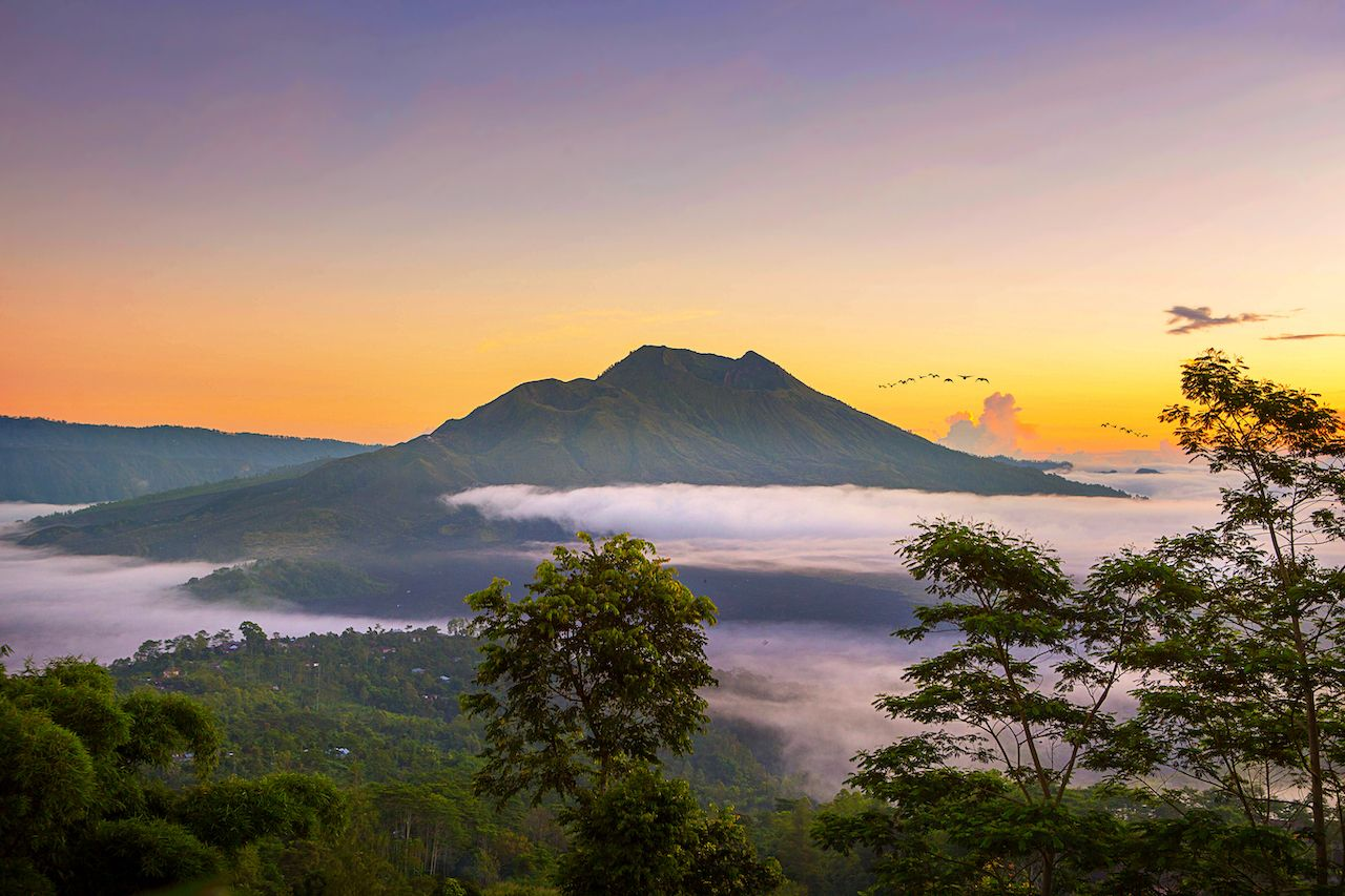 Scenic sunrise and mist at Batur volcano, Kintamani, Bali, Indonesia