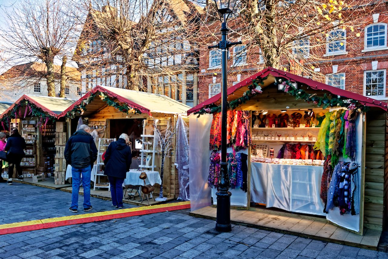 Shoppers at the Christmas Market in Salisbury, UK