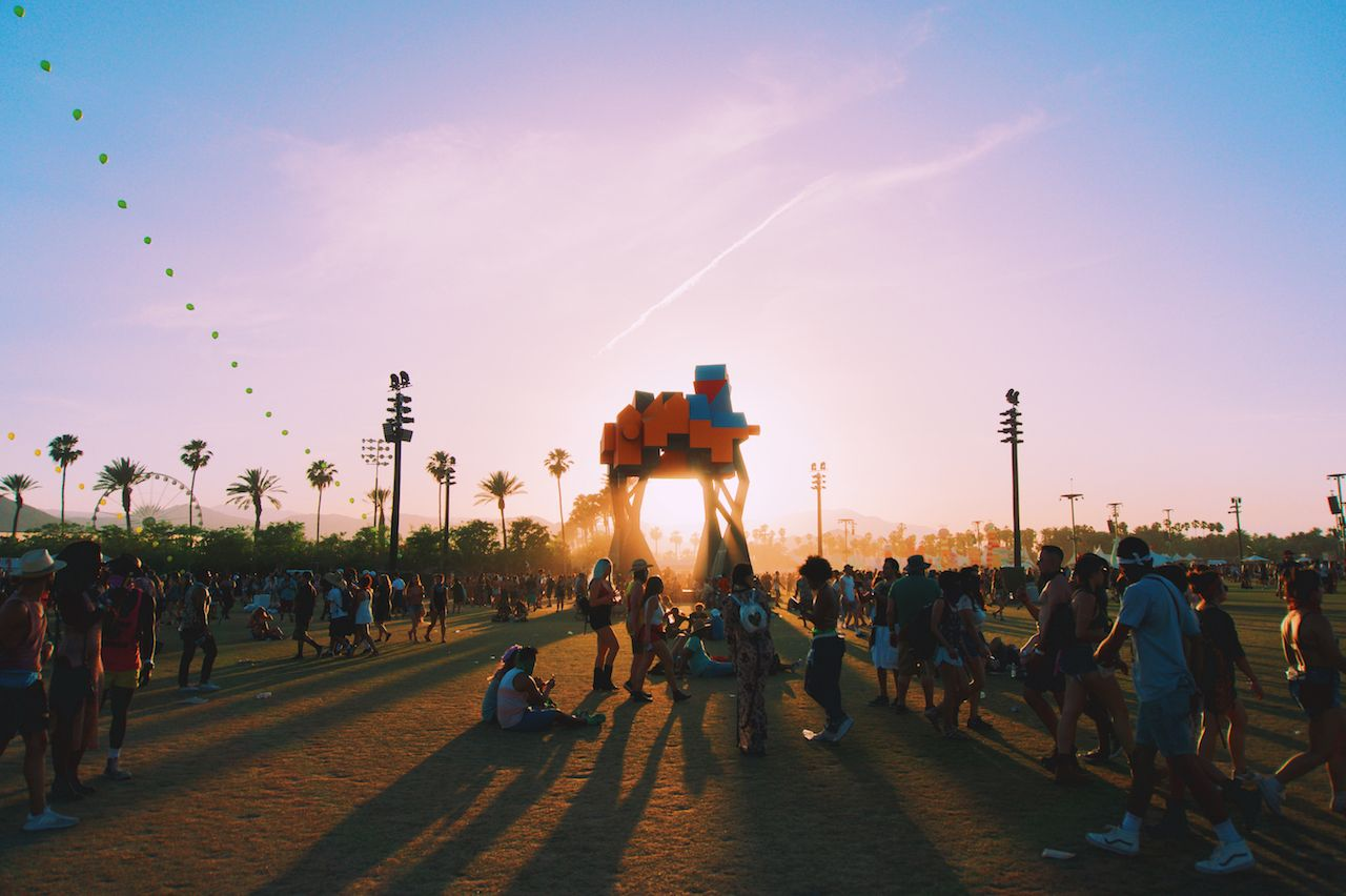 Sun setting behind art installation at Coachella,