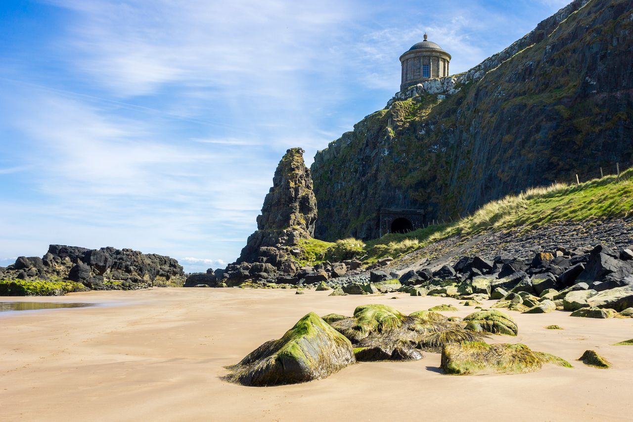 The iconic Mussenden Temple on top of the cliffs of Downhill Beach