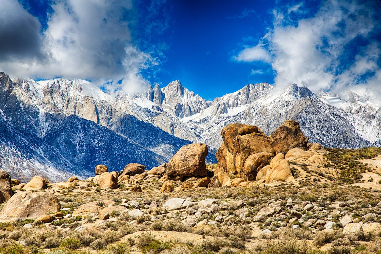 The peak of Mount Whitney as it breaks through the clouds