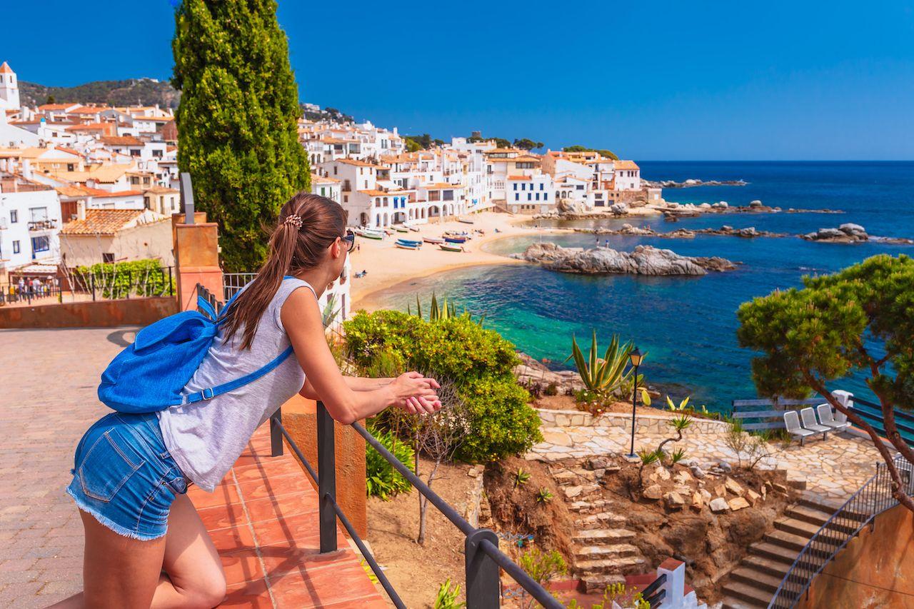 Tourist woman in Calella de Palafrugell, Catalonia, Spain near Barcelona