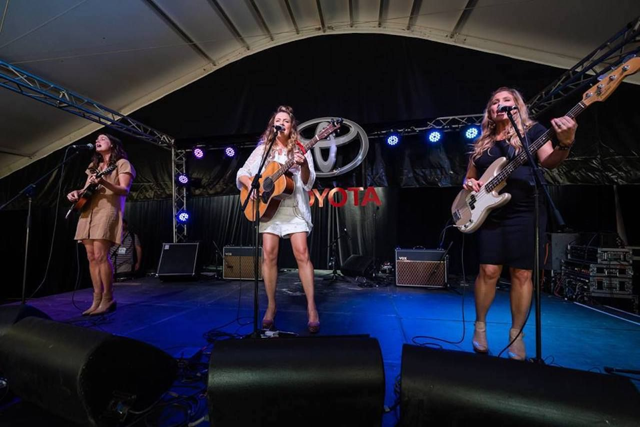 Trio of singers on stage at the Tamworth Country Music Festival