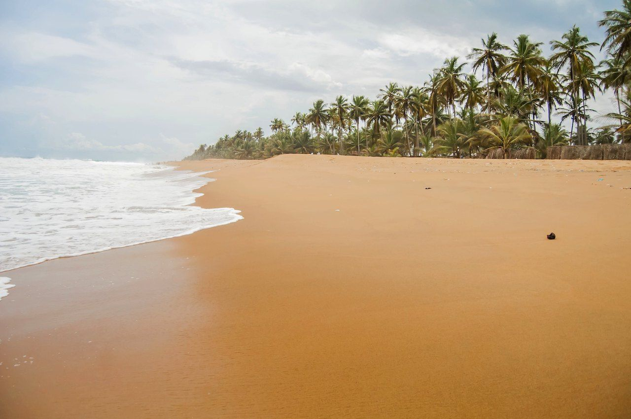 Tropical Azuretti beach on the Atlantic ocean coast in Grand Bassam
