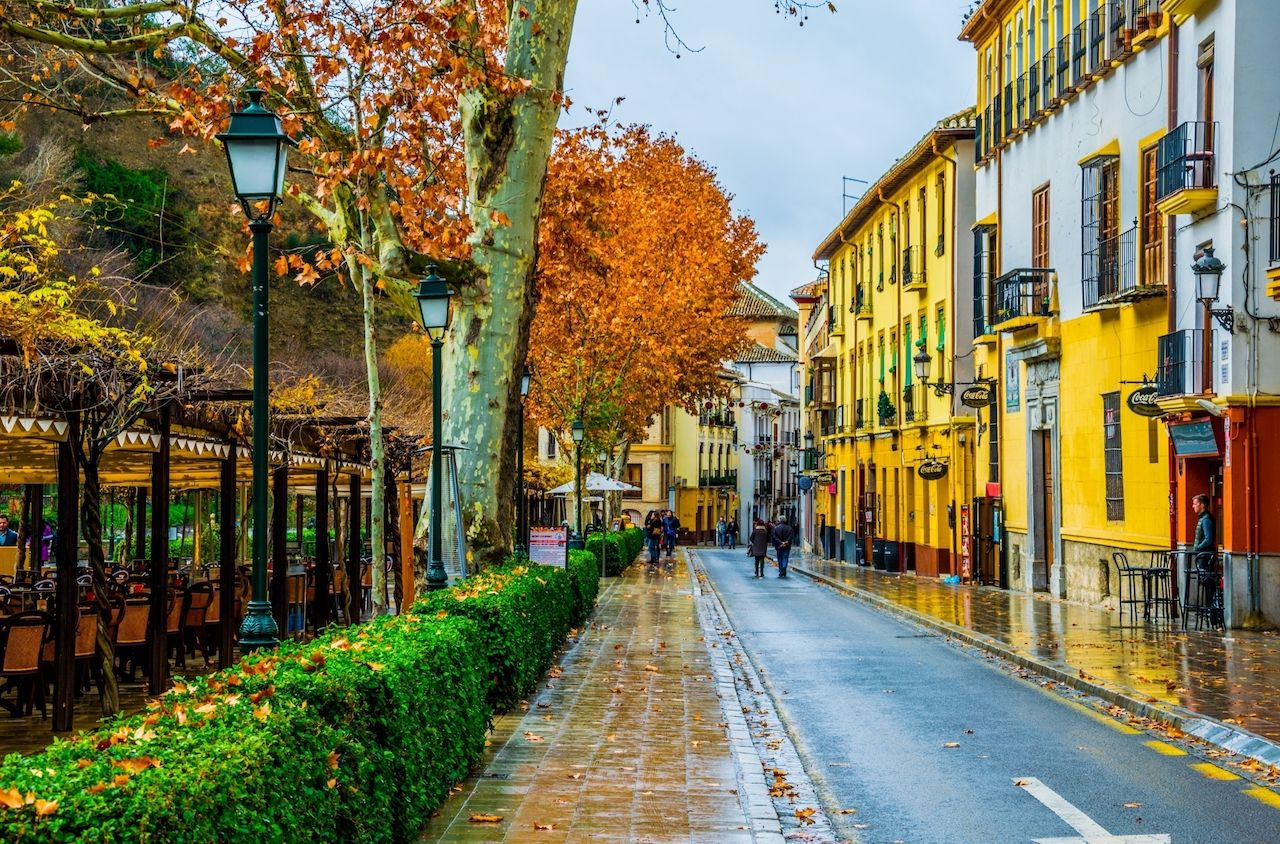 View of a street with bars and restaurants situated on riverside of river darro in spanish city granada