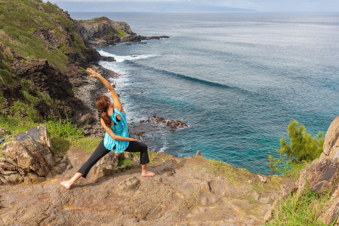 Woman Practicing Yoga on the Maui Coast