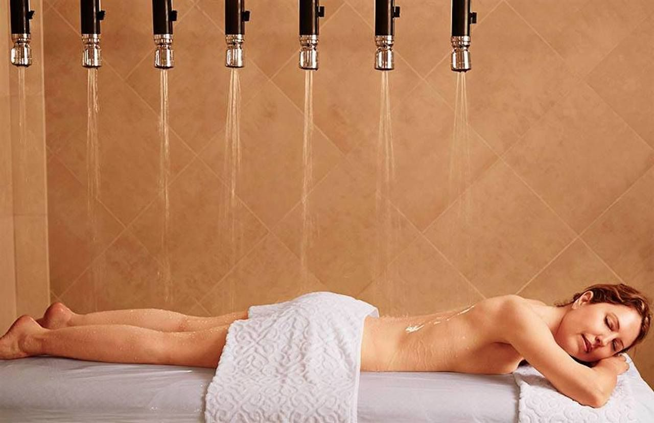 Woman on a massage table getting hydrotherapy