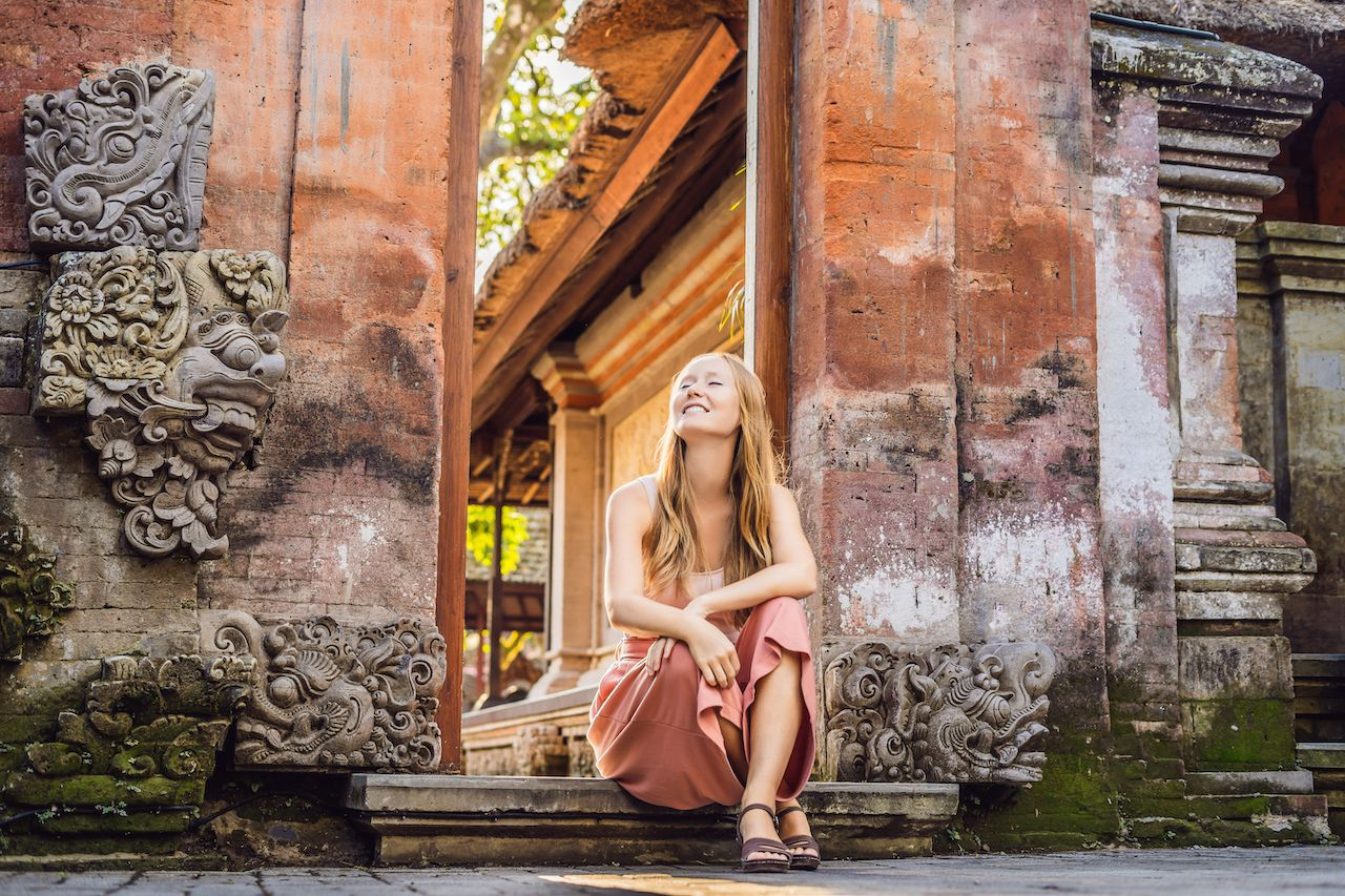 Young woman traveler in Ubud palace, Bali