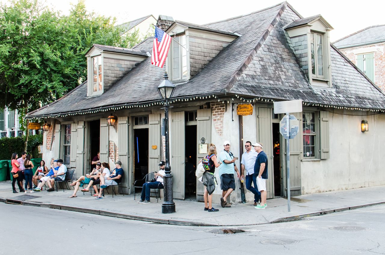 People sitting by Lafitte's blacksmith shop bar in New Orleans