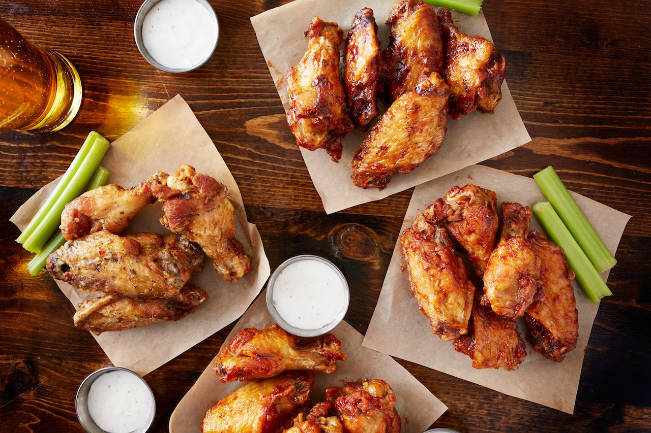 party sampler platter made to share with different flavors of chicken wings served with beer and ranch dipping sauce