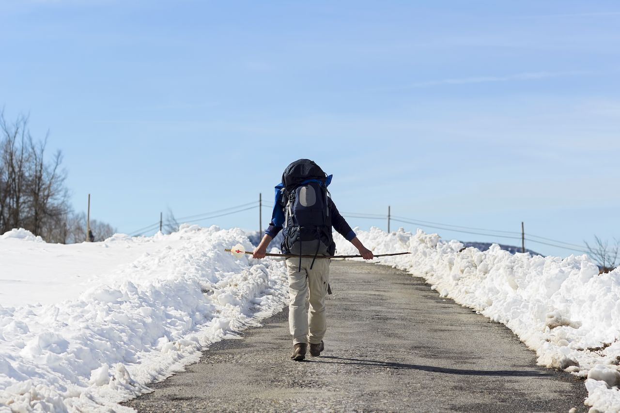 pilgrim in winter with snow in St. James Way