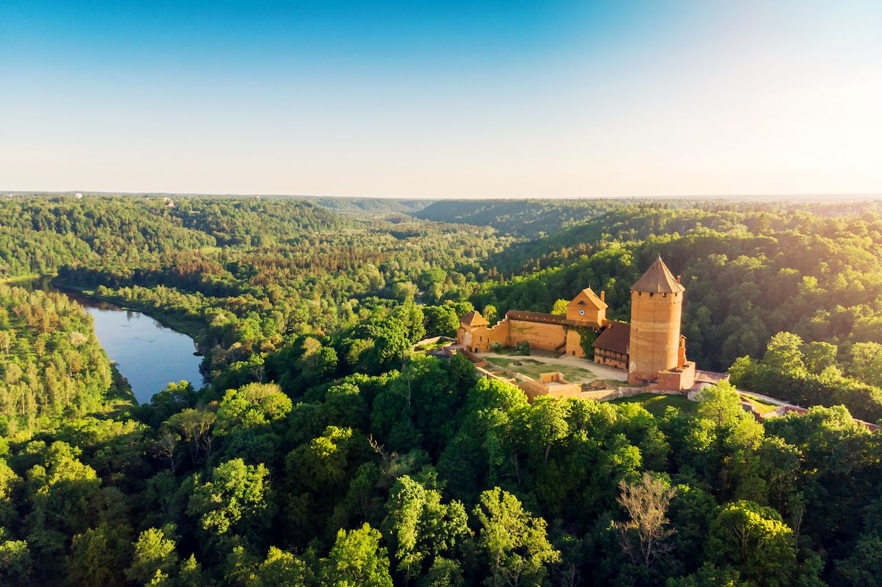 Aerial view to the Turaida Castle and Gauja River at sunset, Latvia