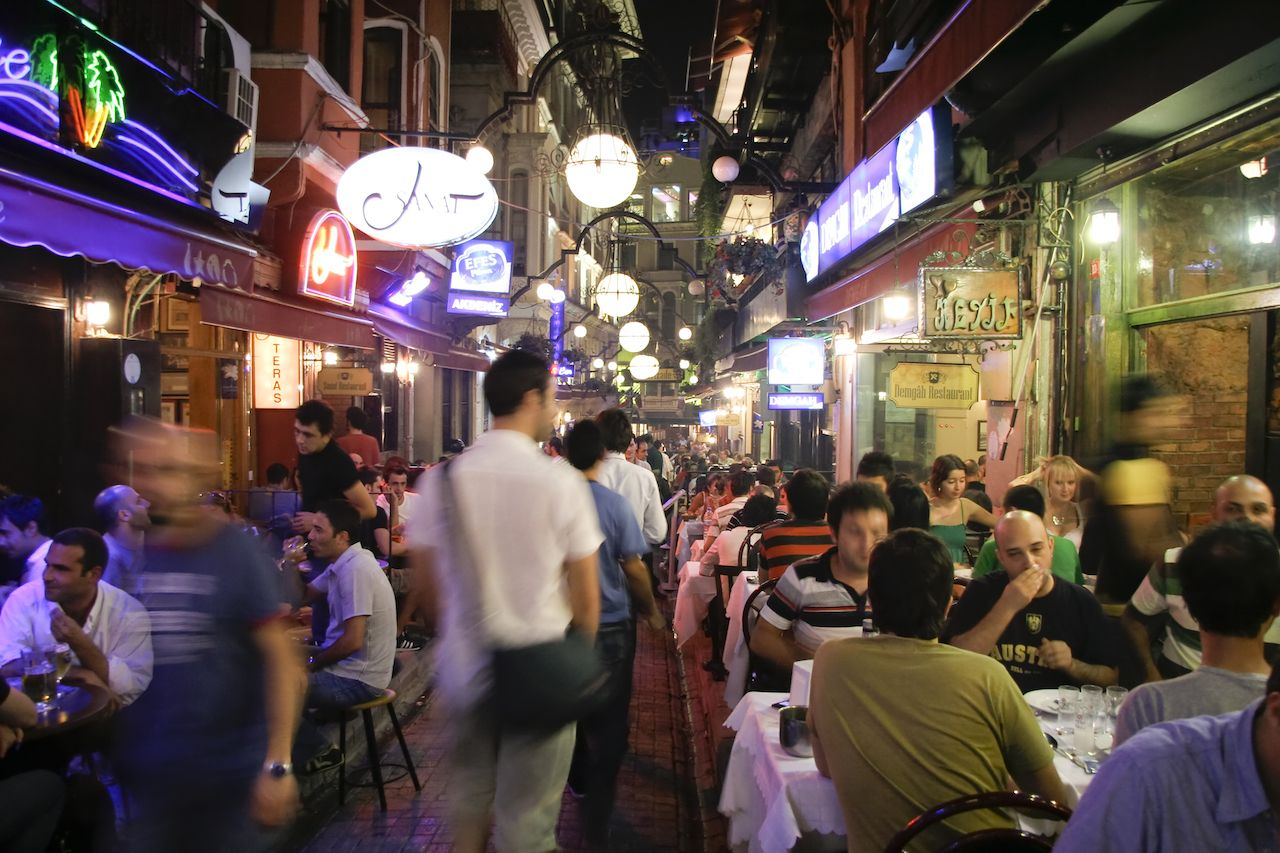 Busy restaurant and bar scene at night in Taksim, Istanbul, Turkey