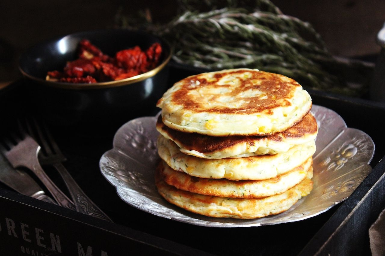Cheese and corn pancakes with rosemary