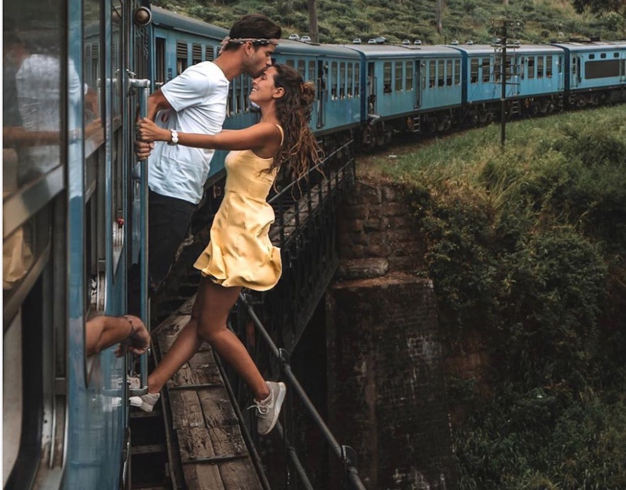 Couple takes photo from train