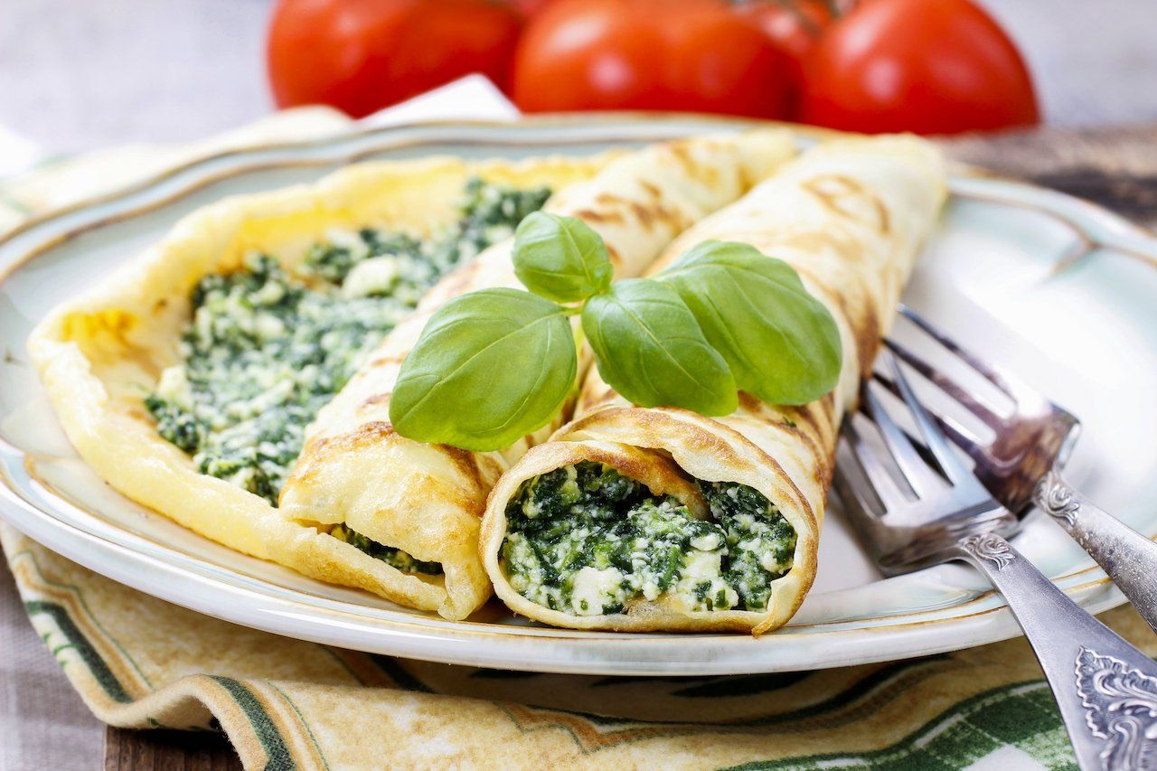 Crepes stuffed with cheese and spinach