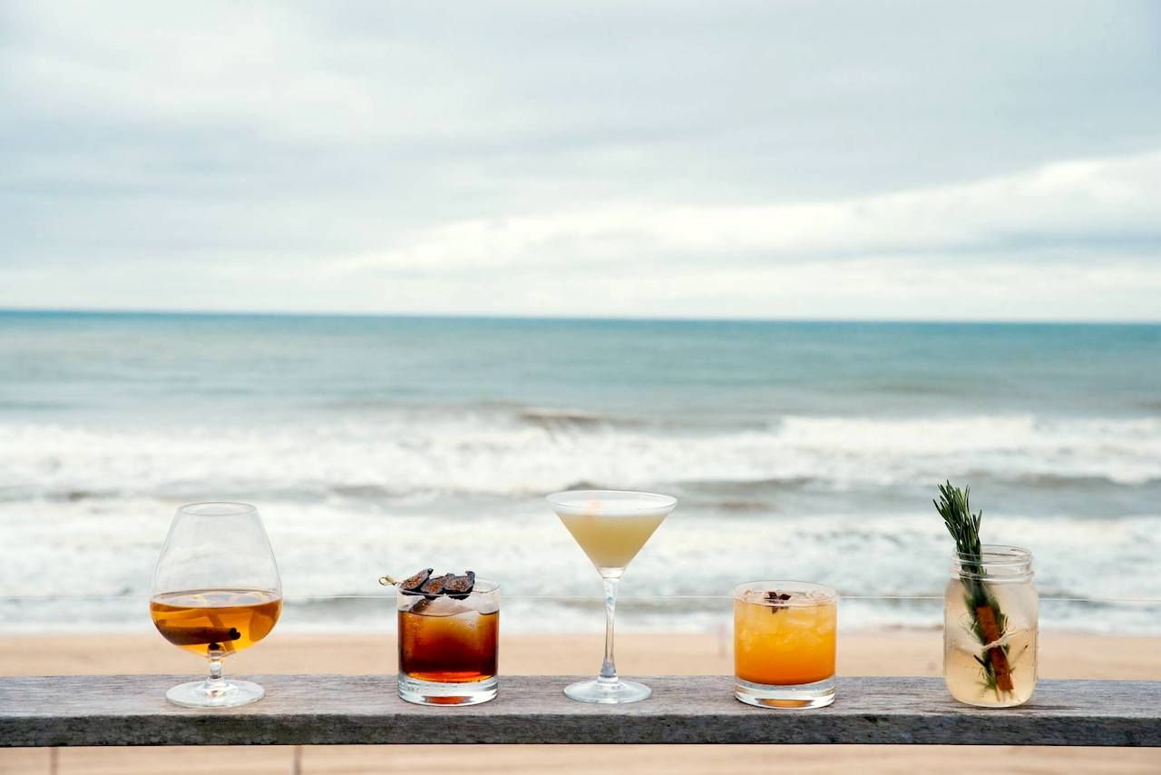 Drinks on a table with a beach view in Montauk, New York