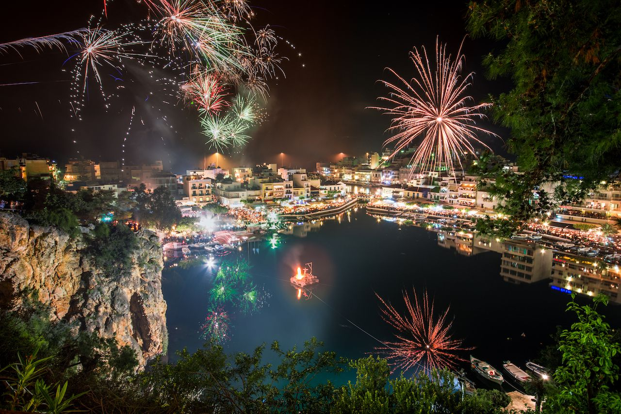 Fireworks over the lake of Voulismeni at Agios Nikolaos, Crete, Greece during Easter