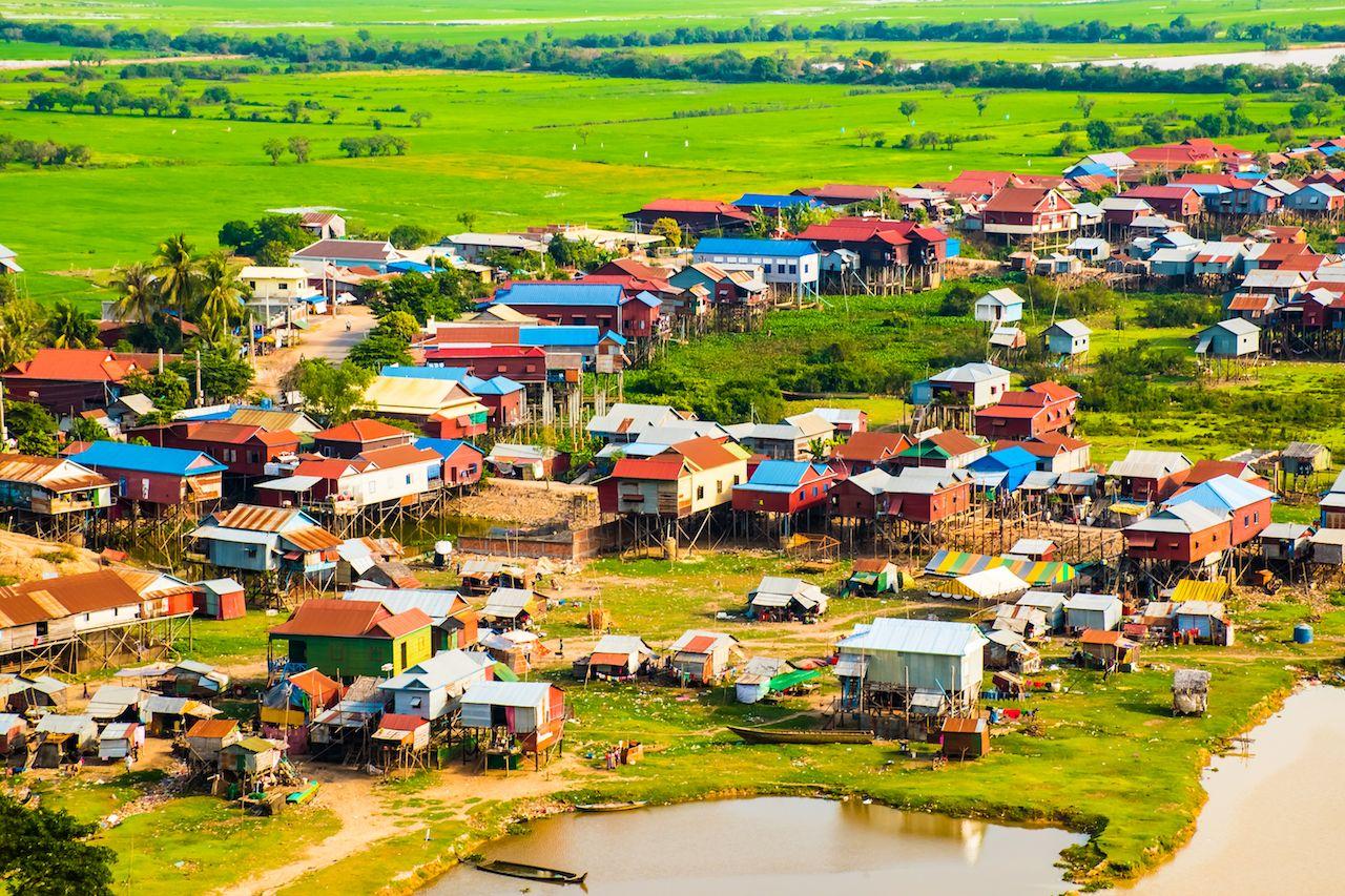 Floating Phnom Krom village, green rice fields in Tonle Sap, Siem Reap, Cambodia