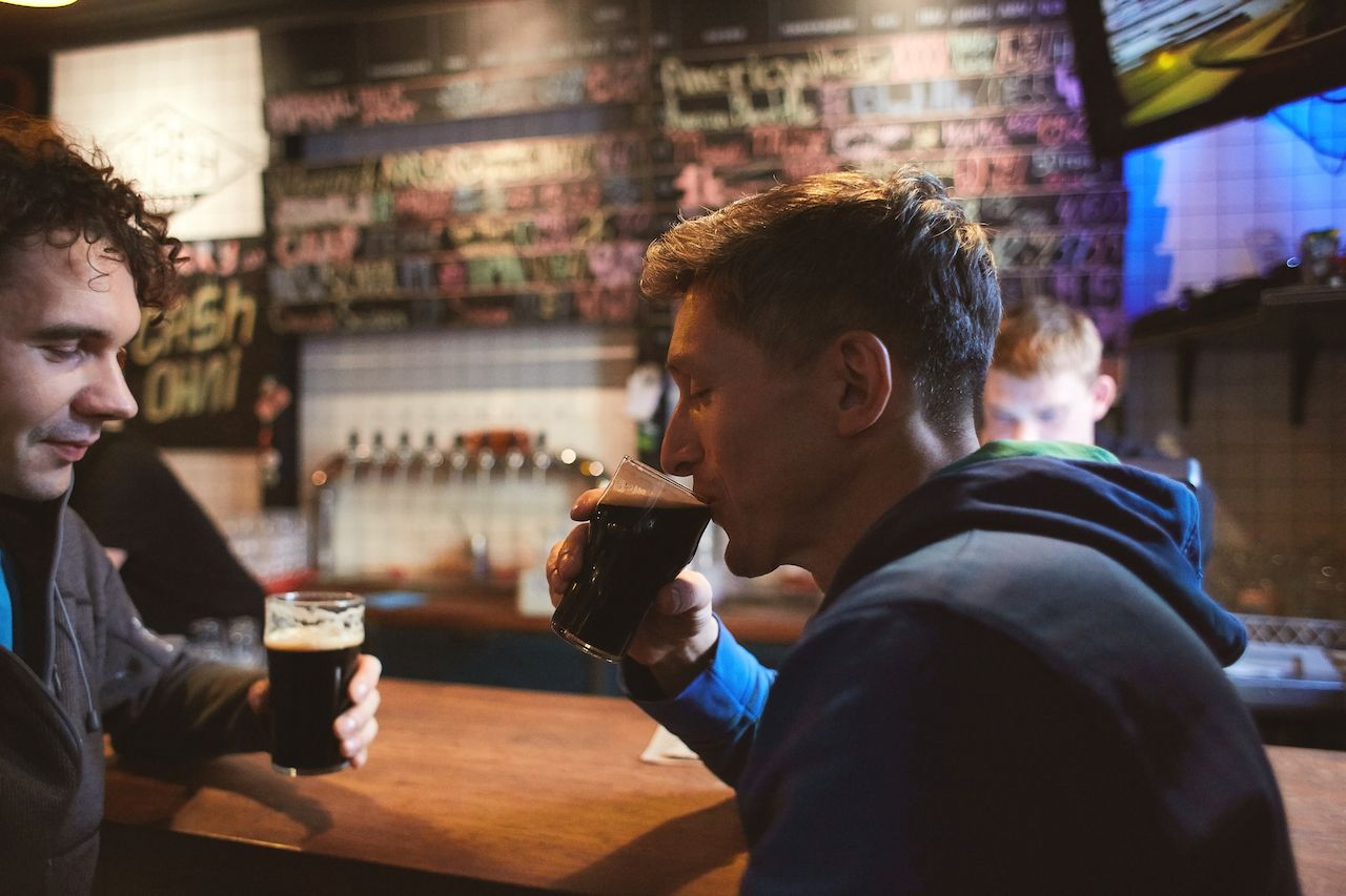 Friends drink Guinness