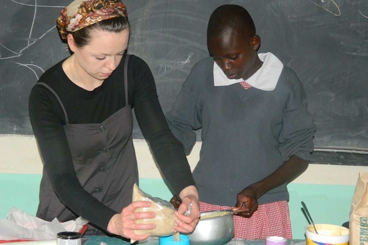 Two women baking together in Kenya