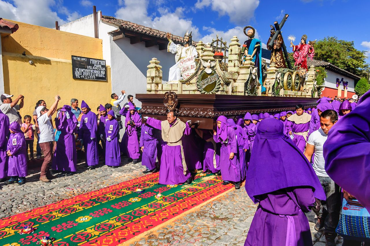 Lent procession walks over dyed sawdust carpet in Antigua, Guatemala
