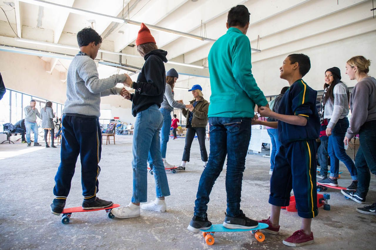 Mexican migrant kids learning to skateboard