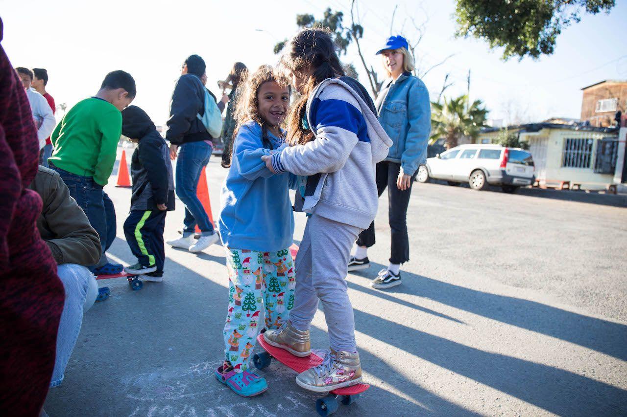 Migrant kids learning to skateboard