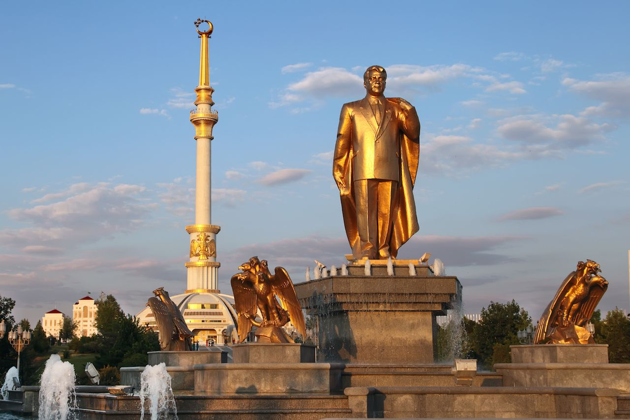 Monument of Niyazov and Arch of Independence in sunset