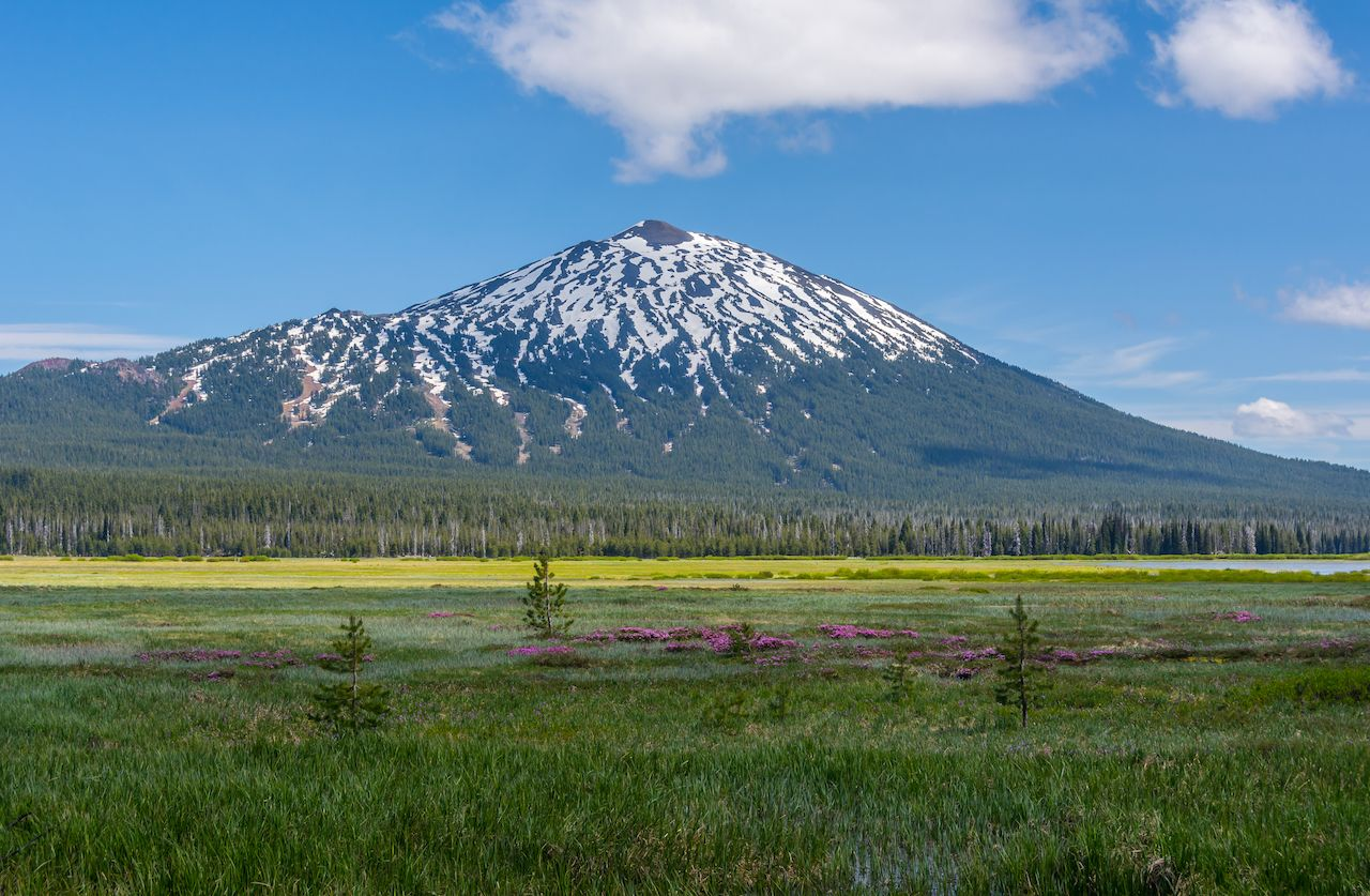 Mount Bachelor photographed in late spring from across the lake at Sparks Lake, one of the lakes on Cascade Lakes Scenic Byway near Bend, Oregon
