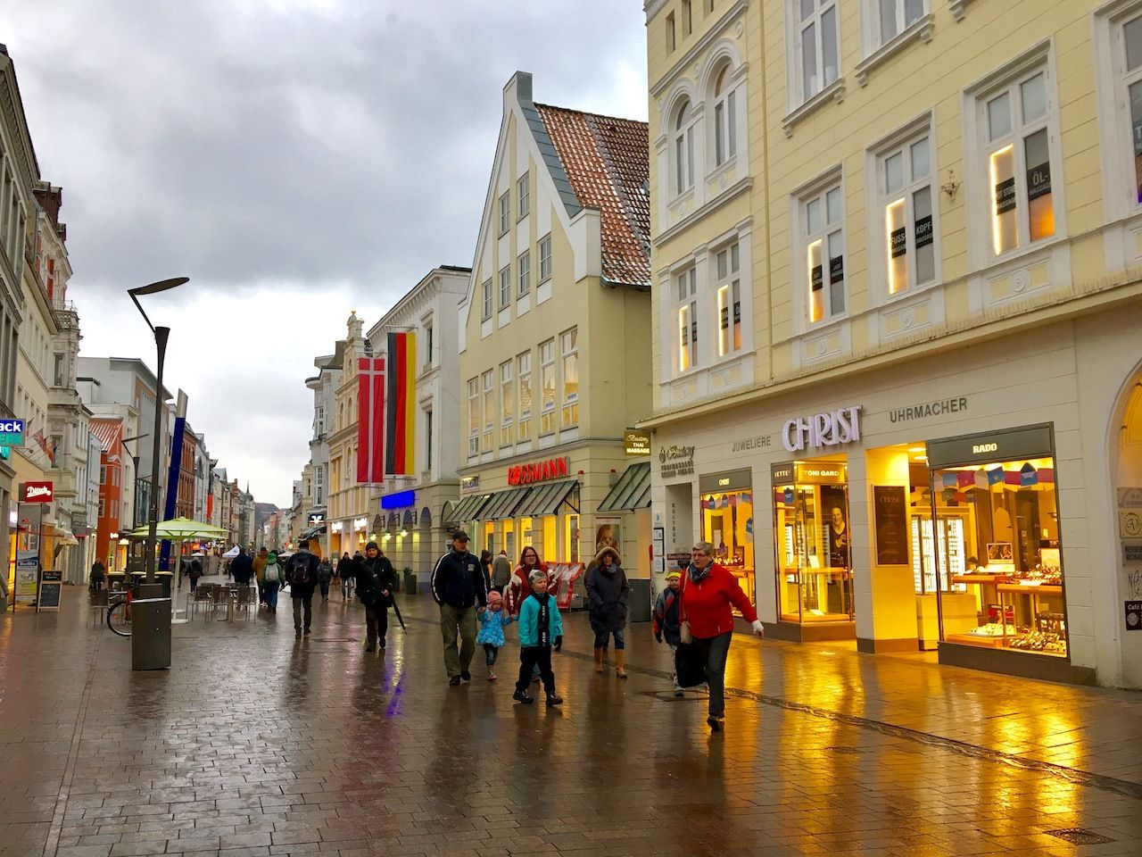 Ordinary people walk on Holm street in Flensburg old town