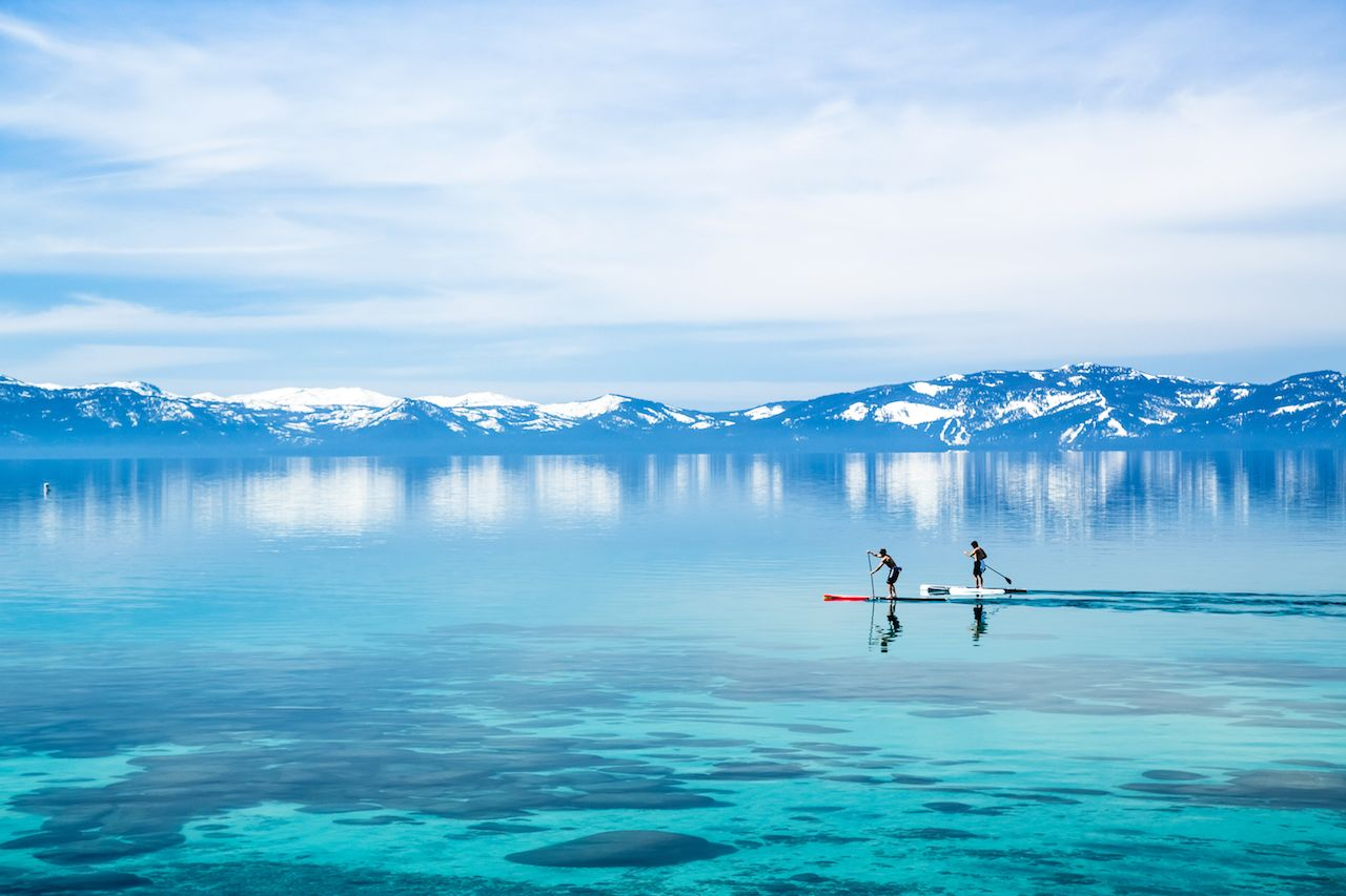 Paddle boarding surrounded by mountains
