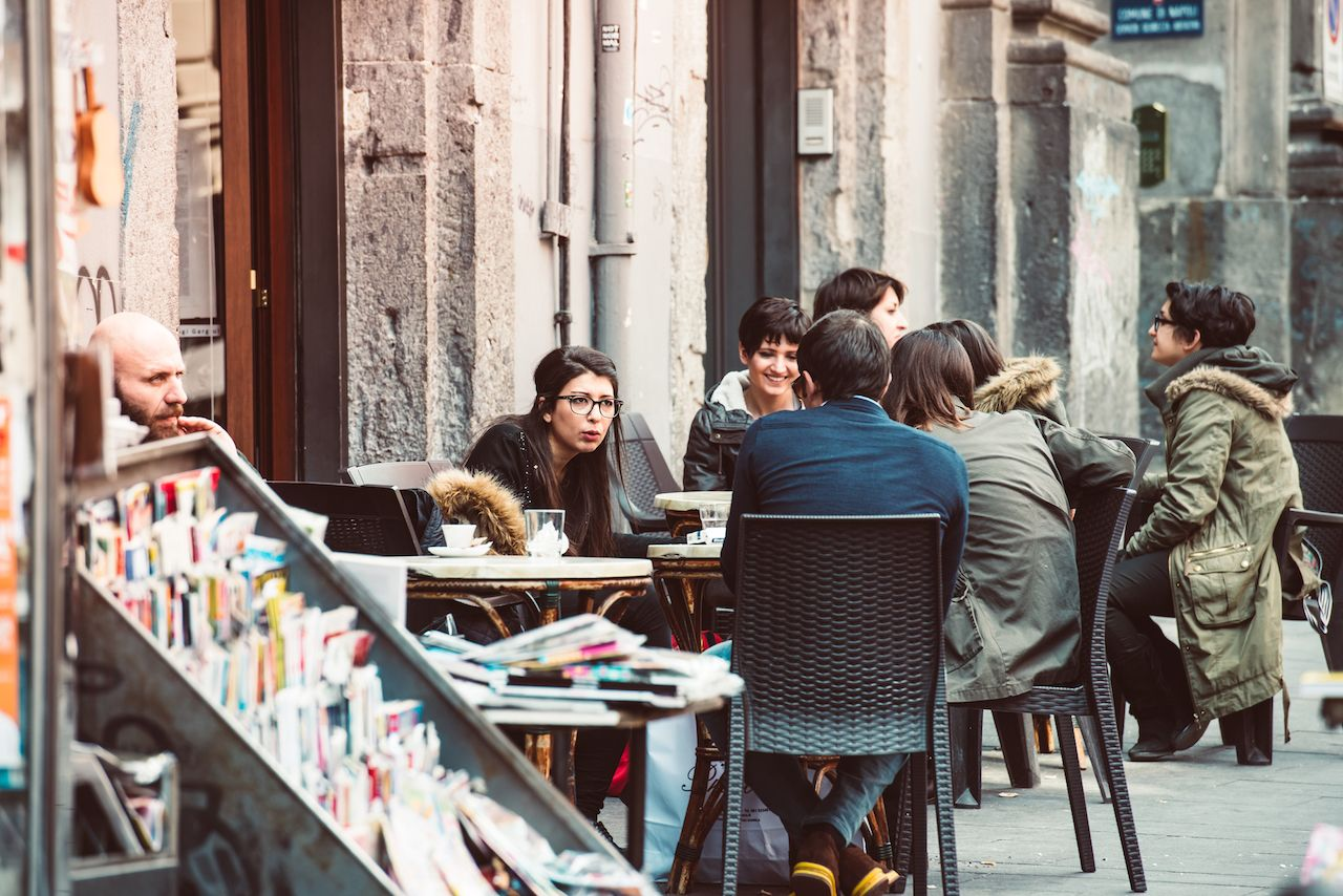 People eating at small cafe in Naples, Italy