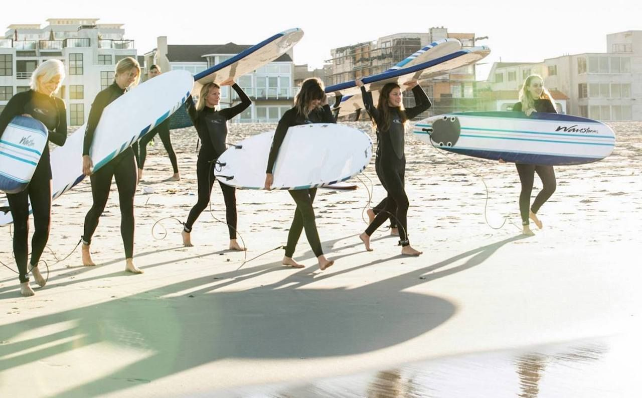 People holding surfboards