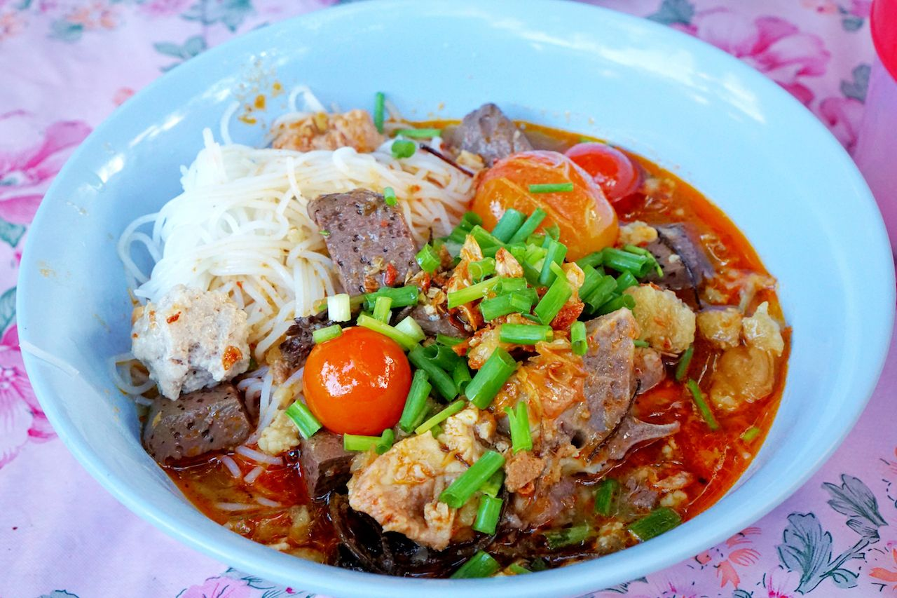 Rice noodles with spicy pork sauce in bowl,